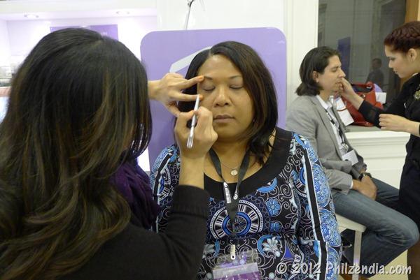 Duane Reade VIP blogger Linda having her makeup applied