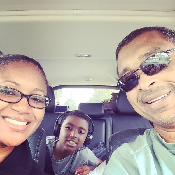 Family selfie in the Mitsubishi Outlnder GT before we started our trip