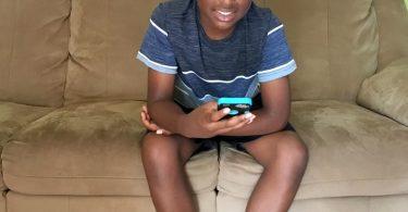 My child enjoying his handheld device